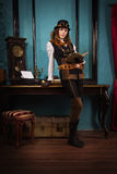 Steam punk girl with old book Royalty Free Stock Images