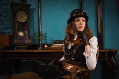 Steam punk girl and old typewriter Stock Photos