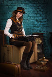 Steam punk girl and old typewriter Stock Image