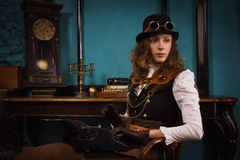 Steam punk girl and old typewriter Royalty Free Stock Photo