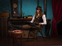 Steam punk girl and old typewriter Royalty Free Stock Photography