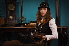 Steam punk girl and old typewriter Royalty Free Stock Photos