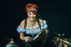 Steam-punk girl portrait on dark background stock photos