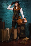 Steam punk girl with suitcase Royalty Free Stock Photos
