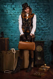Steam punk girl with suitcase Stock Photography