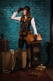 Steam punk girl with suitcase Stock Image