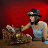 Steam punk girl with Typewriter. Royalty Free Stock Images
