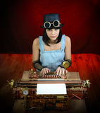 Steam punk girl with Typewriter. Royalty Free Stock Photography