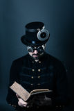 Steam punk man reading Stock Images