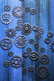 Steam punk mechanical cogs gears wheels on blue background.  royalty free stock image