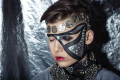 Steam punk nightmare. Mechanical style steam punk nightmare. Creative dark make-up, conceptual idea for Halloween. volume spikes body art painting. Professional Stock Images