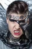 Steam punk nightmare. Mechanical style steam punk nightmare. Creative dark make-up, conceptual idea for Halloween. volume spikes body art painting. Professional Royalty Free Stock Photos