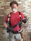 Steampunk white beard thug in front of a brick wall Royalty Free Stock Photos