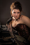 Steam punk woman with typewriter Royalty Free Stock Photos