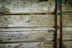 Steam punk wooden background. Of boards fastened with a metal belt royalty free stock images