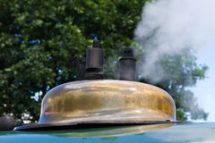 Steam railway. Steam engine releasing steam into the air Royalty Free Stock Photos