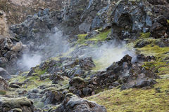 Steam raising among rocks in Landmannalaugar area, Iceland Stock Image