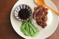 Steam rice with grilled meat. Chinese food--Steam rice with grilled meat peas and sauce Stock Images