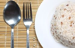 Steam rice with spoon and fork Stock Photos