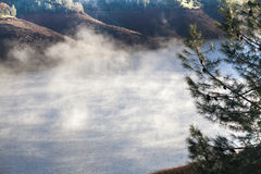 Steam rises above the reservoir. Royalty Free Stock Photo