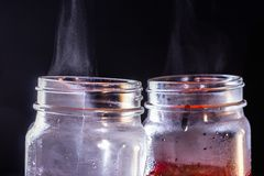Steam rises from cocktail cans covered with condensate due to temperature differences. Brewing tea.  stock image