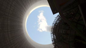 Steam rises from cooling tower stock video footage