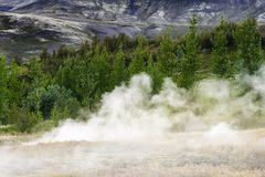 Steam rises from the ground stock image