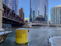 Steam rises off of the Chicago River near Lake Street bridge as temperatures plummet. During January winter stock images