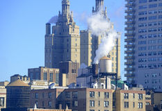 Steam rising from building rooftops in Manhattan, New York Royalty Free Stock Photography