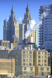 Steam rising from building rooftops in Manhattan, New York Stock Photos