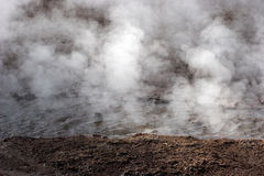 Steam rising from hot spring, geyser field, Chile Royalty Free Stock Photos