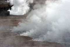 Steam rising from hot spring, geyser valley, Chile Stock Photos