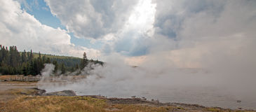 Steam rising off Black Warrior hot springs geyser and Hot Lake in Yellowstone National Parks Lower Geyser Basin in Wyoming USA Royalty Free Stock Images
