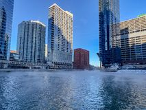 Steam rising off of Chicago River at Wolf Point. During winter in January, as temperatures plummet stock photos