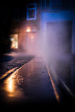 Steam rising through road at night time Stock Images