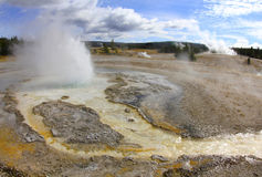 Steam rising volcanic thermal fissures, yellowstone nat park,usa Stock Photos