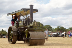 Steam road roller. POTTEN END, UK - JULY 27: A large vintage traction engine leaves the show grounds heading toward the departure and loading area at the Dacorum Stock Photo