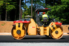 Steam Roller 2. Heavy road construction equipment in road Royalty Free Stock Photography