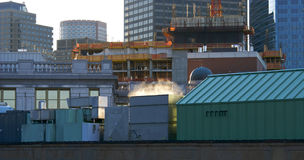 Steam on roof. Roof top view of layered buildings with steam rising from the closest one Royalty Free Stock Photo