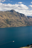 Steam ship cruses mountain lake. View from the mountain tor over lake Wakatipu, Central Otago, New Zealand stock photography
