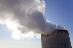 Steam or Smoke Coming Out Of a Chimney Stock Images