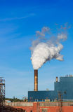 Steam and smoke from a factory chimney Stock Photography