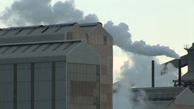 Steam and smoke in an industrial setting. England and industrial landscape with smoking chimney stock video