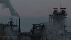 Steam and smoke in an industrial setting evening time. England and industrial landscape with smoking chimney stock video