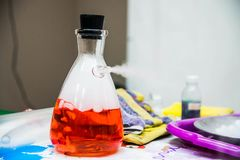 Steam from the spout of the plugged flask. A science experiment stock photography