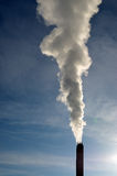 Steam from stack against blue sky Stock Photography