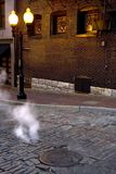 Steam Street 2. Steam rising from a grate on a street Stock Images