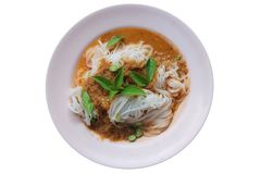 Steam Thai rice vermicelli with red curry and vegetables. Rice noodles in fish curry sauce with vegetables on a  pink disk isolate royalty free stock image