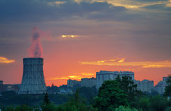 Steam from thermal station pipe at dawn Stock Photos