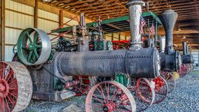 Steam threshers on display. Steam threshers lined up together for display at the fairgrounds stock image